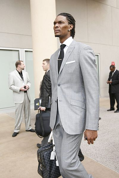 Chris Bosh - tall man in a gray suit