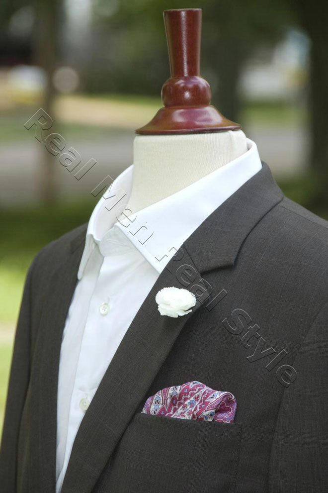 white boutonniere pink pocket square mens jacket