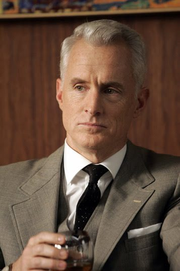 Roger Sterling in a suit