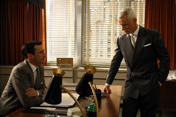 Roger Sterling in a pinstripe suit with peaked lapels