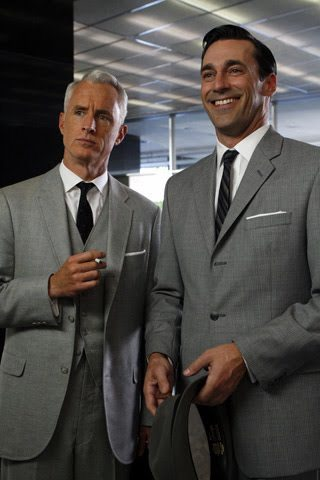 Roger Sterling and Don Draper wearing light grey three-piece suits