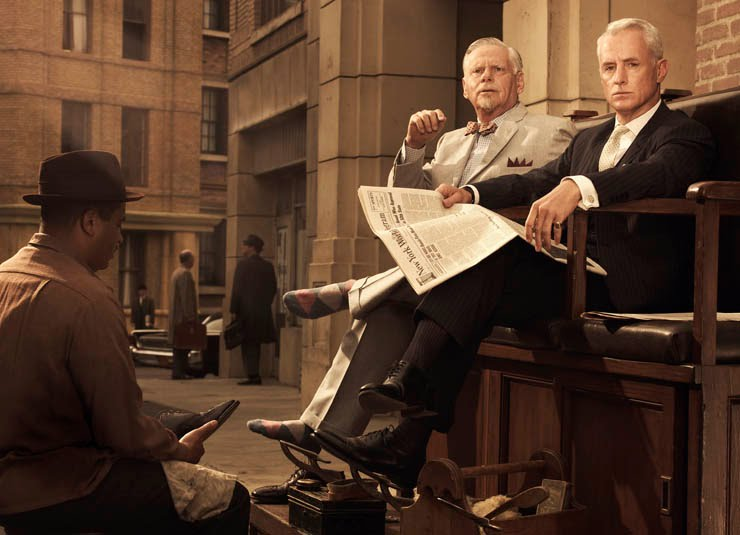 Roger Sterling getting his shoe shined