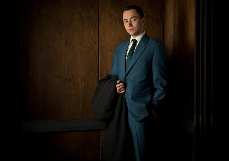Pete Campbell in navy blue suit - school pride necktie