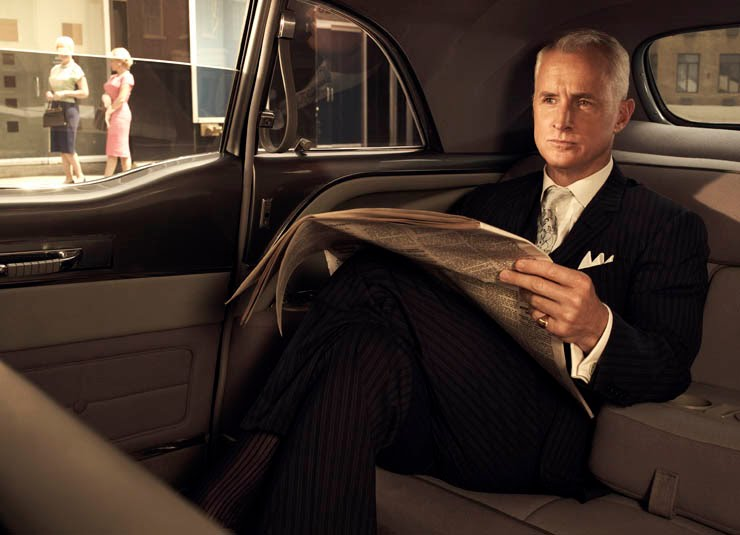 Roger Sterling inside a car