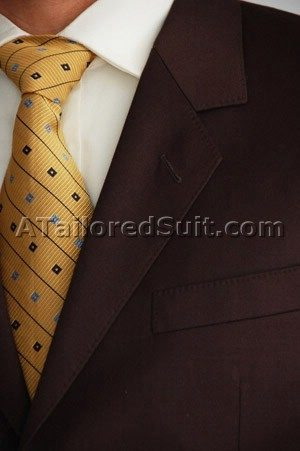 Men's brown suit with golden tie